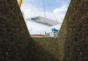 Carillion being lowered into a grave
